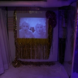 "Installation of Amy Kligman's The Glory Days Will Not Last Forever featuring ""20 Minutes of Forever"" a video by Melissa Lenos"